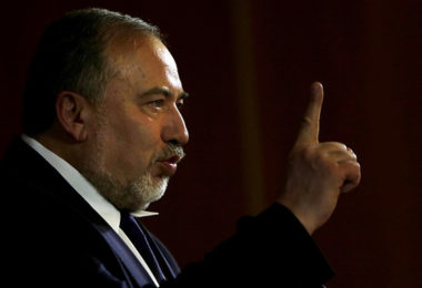 Israeli Foreign Minister Avigdor Lieberman gestures as he delivers a speech at the Conference of Presidents of Major American Jewish Organizations, on February 15, 2015 in Jerusalem. AFP PHOTO/GALI TIBBON