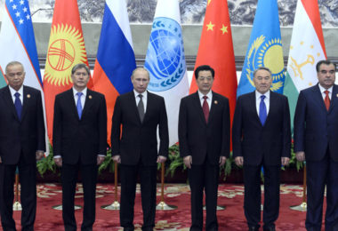 Chinese President Hu Jintao, third right, stands with leaders of Central Asian nations, from left, Uzbekistan's President Islam Karimov, Kyrgyzstan's President Almazbek Sharshenovich Atambayev, Russian President Vladimir Putin, Hu, Kazakhstan's President Nursultan Nazarbayev and Tajikistan's President Emomali Rakhmon, for a group photo at the Great Hall of the People in Beijing Wednesday, June 6, 2012, at the start of the Shanghai Cooperation Organization summit. Central Asian states meeting in Beijing this week say they want a role in stabilizing Afghanistan after most U.S. combat troops leave at the end of 2014, with China's economic juggernaut leading the charge. (AP Photo/Mark Ralston, Pool)