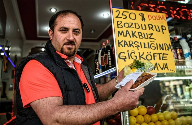 shopkeeper-bulent-baydeniz-in-istanbul-is-one-of-those-supporting-the-government-campaign-afp