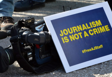 ANKARA - TURKEY - FEBRUARY 27: A group of Al Jazeera Arabic journalists gather to demonstrate outside the Egypt Embassy building demanding the release of Al Jazeera Arabic network journalist Abdullah Al Shami, cameraman Mohamed Badr, Australian journalist Peter Greste and Egyptian-Canadian Mohamed Fadel Fahmy who are being held at Cairo's Tora prison for allegedly supporting the Muslim Brotherhood in capital Ankara, Turkey on February 27, 2014. (Photo by Murat Kula/Anadolu Agency/Getty Images)