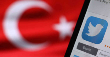 epa04134461 The logo of Twitter is seen on a smartphone held besides a Turkish flag in Kaufbeuren, Germany, 21 March 2014. The social media site Twitter was blocked in Turkey early on 21 March 2014, amid an internet crackdown in the country. Some users said they could not load the site, while others were being redirected to an official website saying a court order was applying 'protection measures.'The move came just hours after Turkish Prime Minister Recep Tayyip Erdogan promised to 'root out' Twitter, after pushing through new legislation last month which allows authorities to shut down websites and track users' browsing histories.  EPA/Karl-Josef Hildenbrand