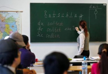 """Migrants attend a lesson at the """"institute for intercultural communication"""" in Berlin, Germany, April 13, 2016. REUTERS/Hannibal Hanschke"""