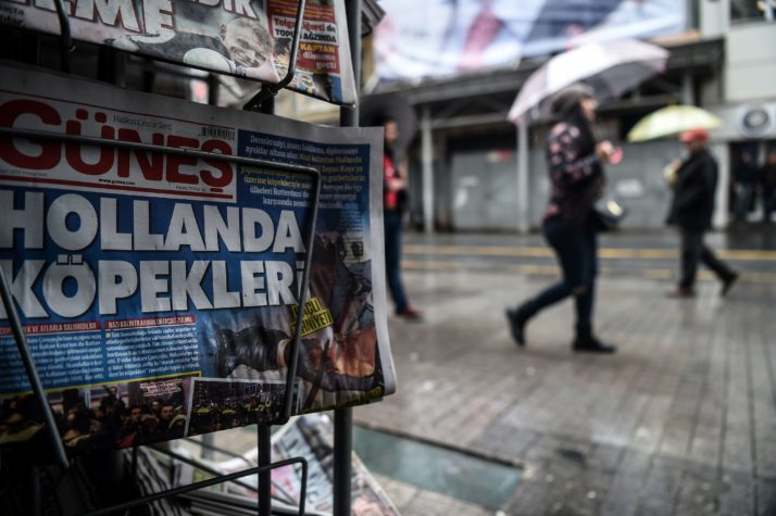 """This picture taken in Istanbul on March 13, 2017 shows a newspaper bearing a headline concerning diplomatic tensions between Turkey and The Netherlands,  which translates as """"""""Dogs of Europe""""  in Istanbul on March 13, 2017. Turkish President Recep Tayyip Erdogan warned the Netherlands would pay for blocking his ministers from holding rallies to win support in a referendum on expanding his powers, as a crisis escalated with Turkey's key EU partners.Erdogan also repeated hugely controversial accusations that the Netherlands -- occupied by Nazi Germany in World War II -- was behaving like fascists in its treatment of Turkish ministers.  / AFP PHOTO / OZAN KOSE        (Photo credit should read OZAN KOSE/AFP/Getty Images)"""
